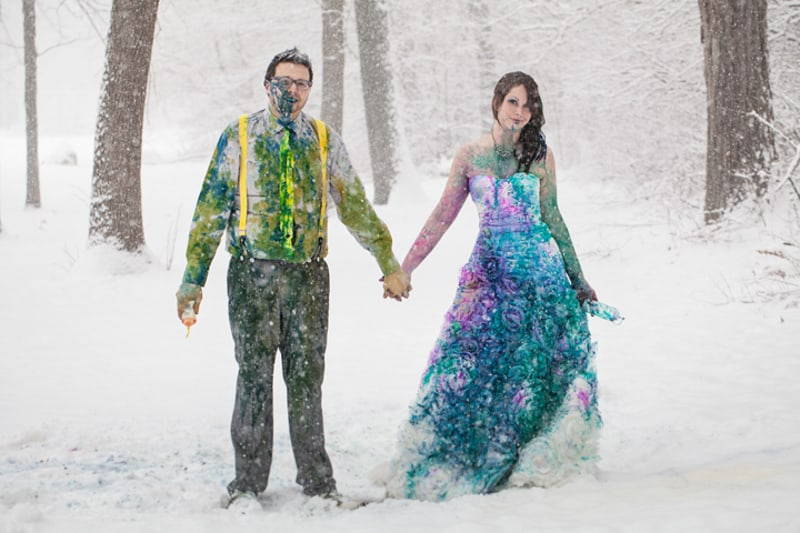 A vibrant trash the dress shoot in the snow bespoke for Painted on wedding dress