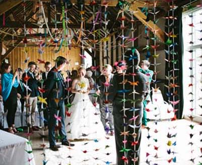 A handmade barn wedding with a thousand origami cranes for 1000 paper cranes wedding decoration