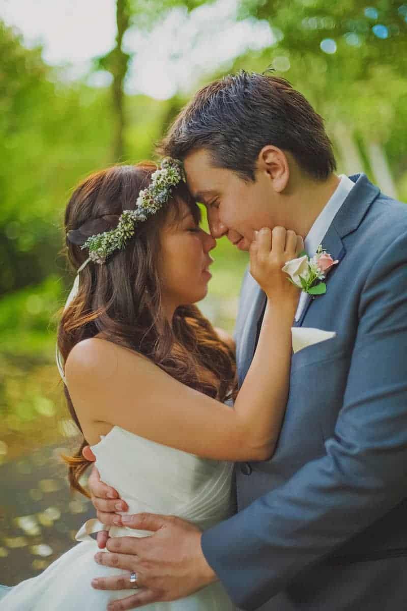 Bride and groom destination wedding Hawaii portrait romantic kiss