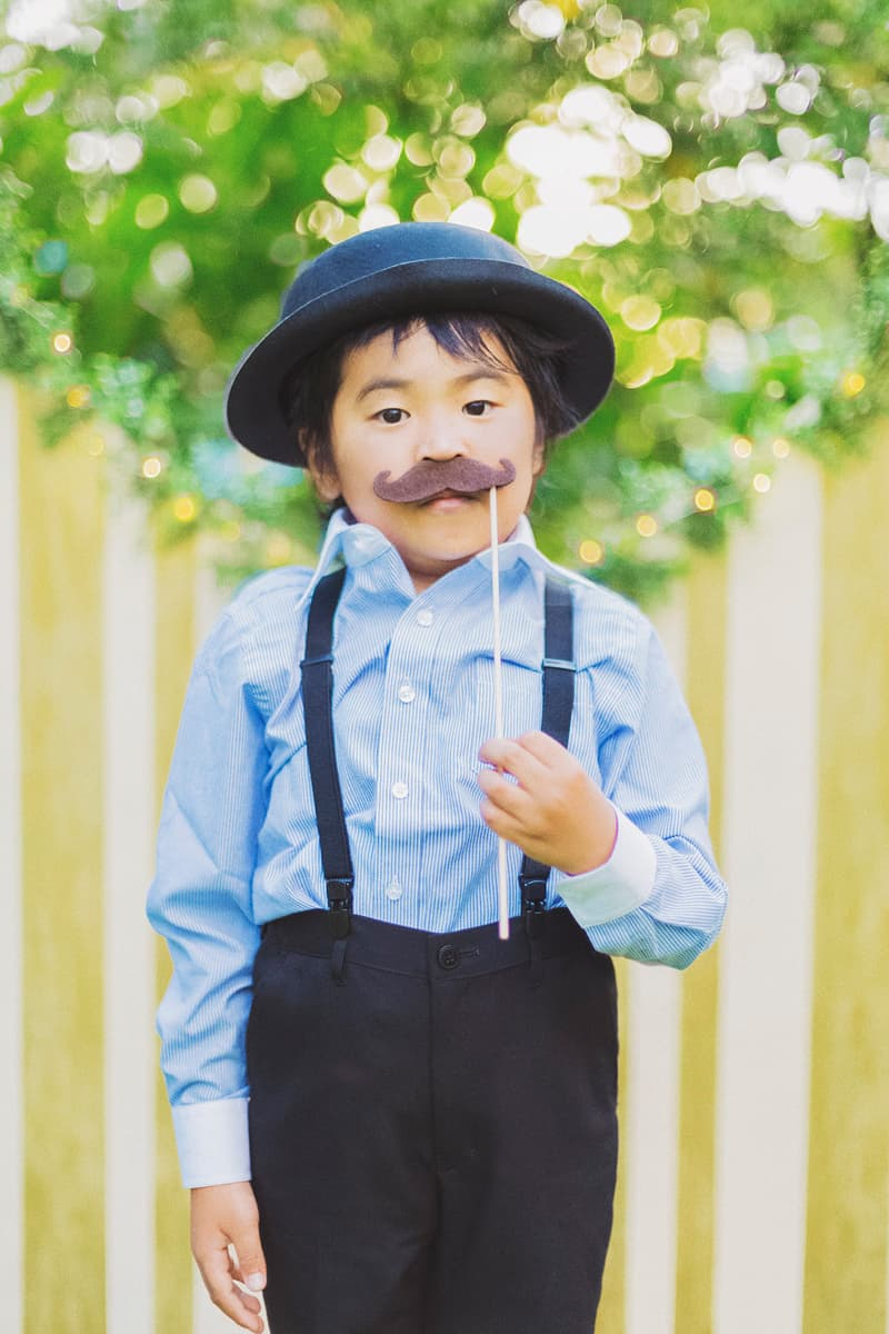 Cute page boy wearing top hat braces in whimsical wedding Hawaii