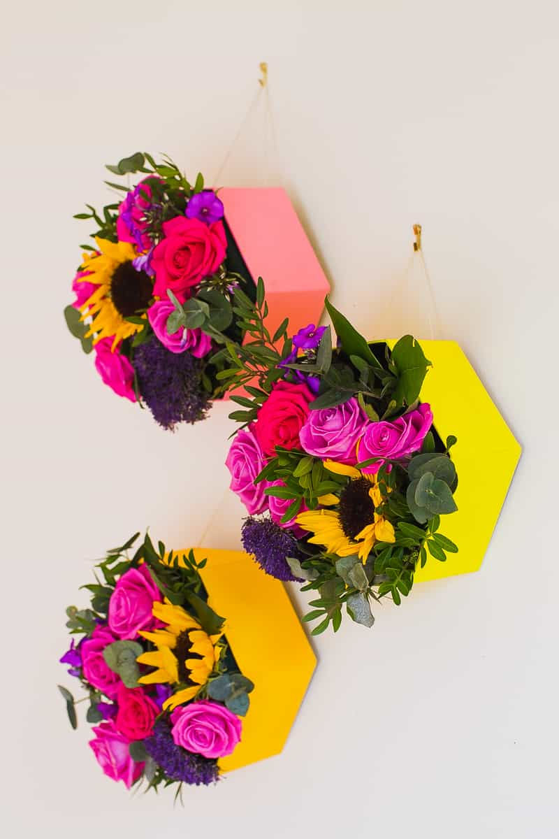 Diy geometric hexagon flower boxes for a pop of colour on for How to hang flowers