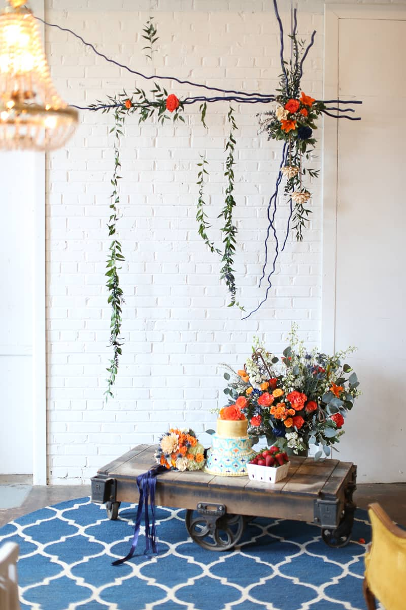 Whimsical Warehouse Wedding Inspiration with Bath tub bride orange navy colour scheme-11
