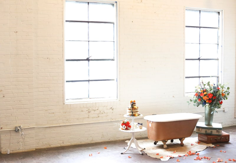Whimsical Warehouse Wedding Inspiration with Bath tub bride orange navy colour scheme-16