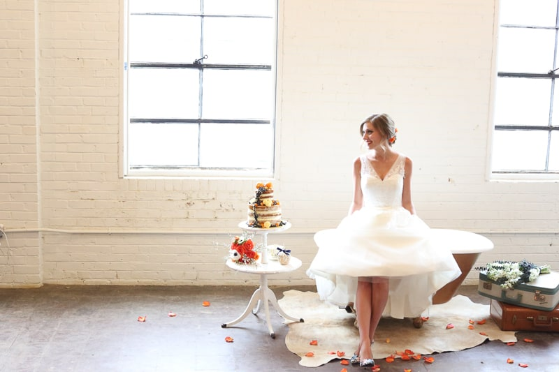 Whimsical Warehouse Wedding Inspiration with Bath tub bride orange navy colour scheme-18