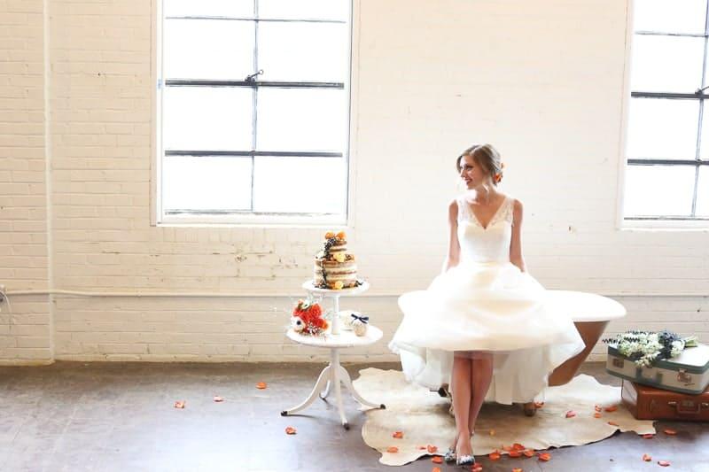 Whimsical Warehouse Wedding Inspiration with Bath tub bride orange navy colour scheme-18