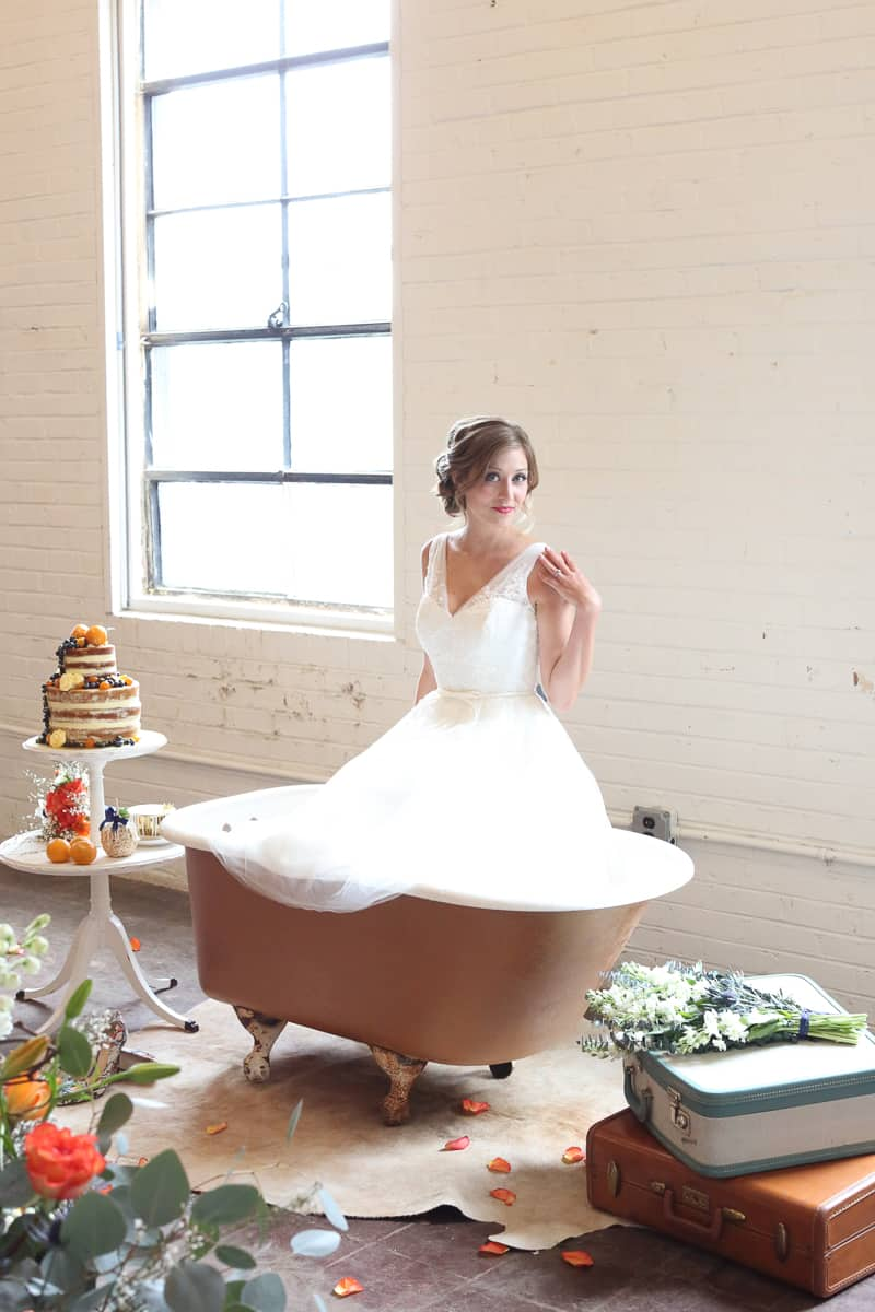 Whimsical Warehouse Wedding Inspiration with Bath tub bride orange navy colour scheme-19