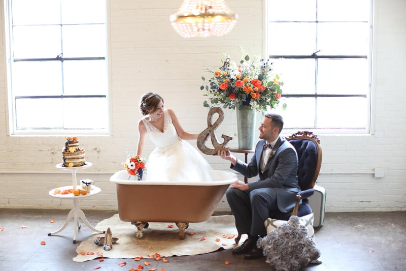 Whimsical Warehouse Wedding Inspiration with Bath tub bride orange navy colour scheme-20