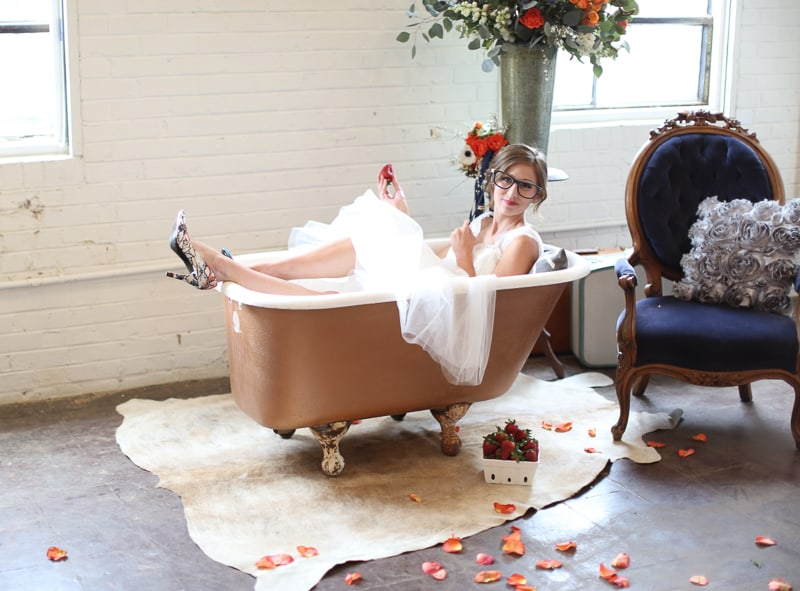 Whimsical Warehouse Wedding Inspiration with Bath tub bride orange navy colour scheme-21