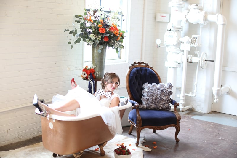 Whimsical Warehouse Wedding Inspiration with Bath tub bride orange navy colour scheme-22