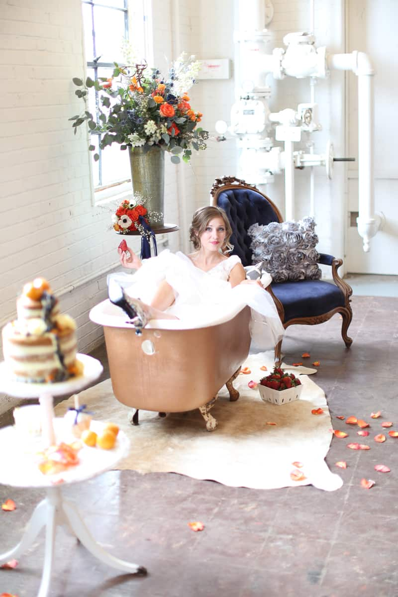 Whimsical Warehouse Wedding Inspiration with Bath tub bride orange navy colour scheme-23