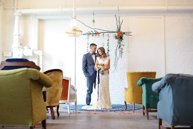 Whimsical Warehouse Wedding Inspiration with Bath tub bride orange navy colour scheme-6