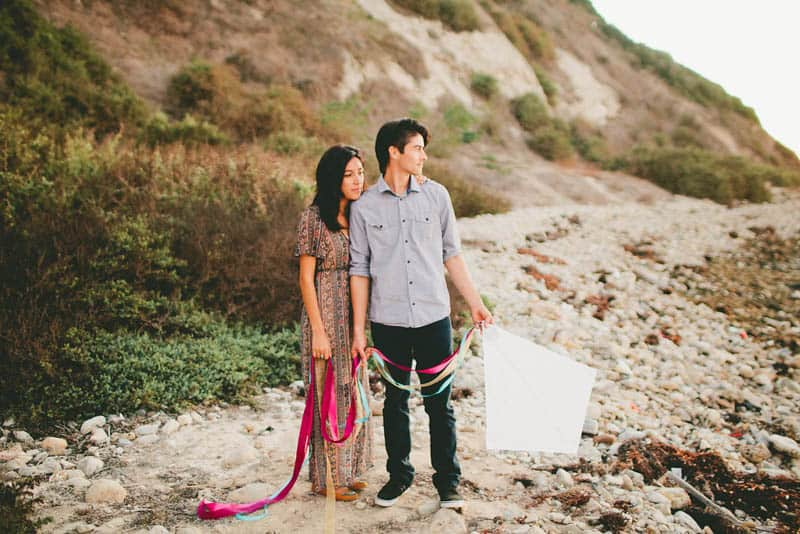 How to make your engagement shoot more personal - a colourful whimsical outdoor picnic engagement on the beach (20)