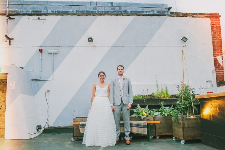 Glamorous-two-piece-wedding-gown-for-a-relaxed-rooftop-wedding-in-Camden-32