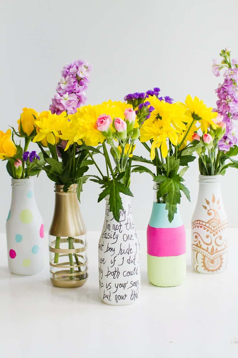 quick & easy wedding DIY's-5-ways-to-decorate-leftover-bottles-for-your-wedding-table-decor-with-paint-spray-paint-sharpies-2