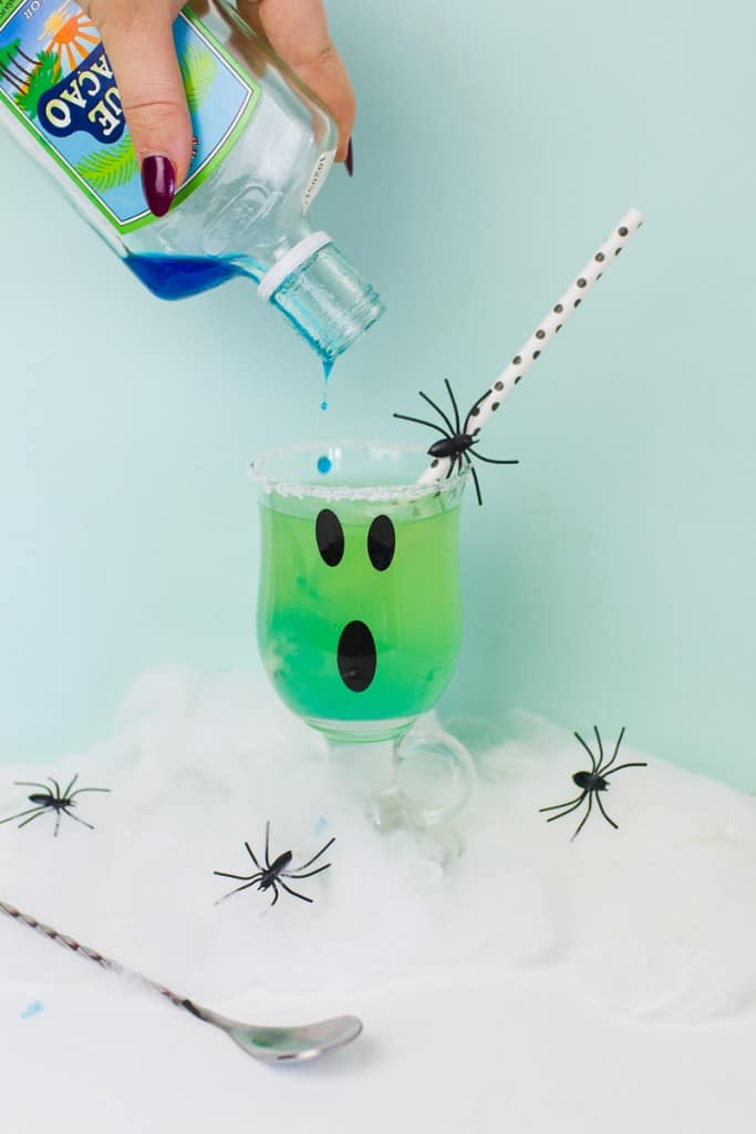 green-halloween-cocktail-recipe-rum-curacao-apple-sours-fun-ghost-spooky-ombre-blue-6